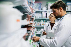 Pharmacist looking at medicines