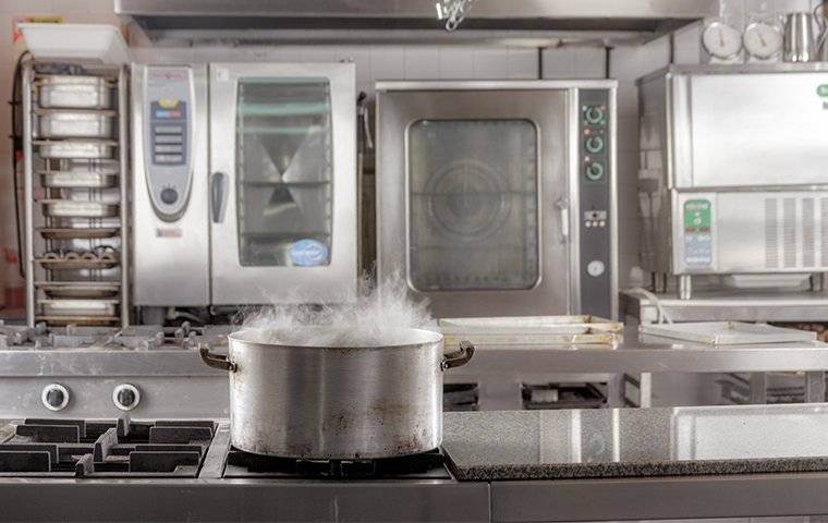 pot smoking on a commercial stove