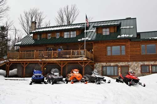 Sleds Parked in back of Lodge