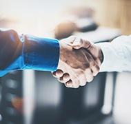 moyer professional shaking hands with new acquistion