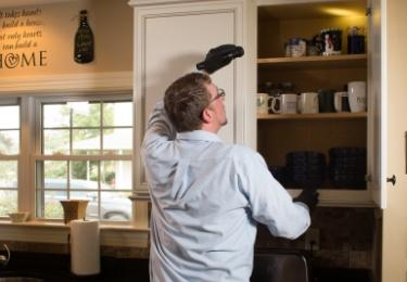 moyer pest control tech inspection kitchen cupboard