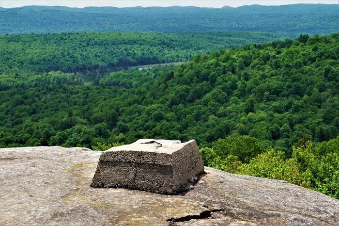All that is left of the former fire tower are the cement footers (Credit: Wm.Hill/Hiking the trail to Yesterday)