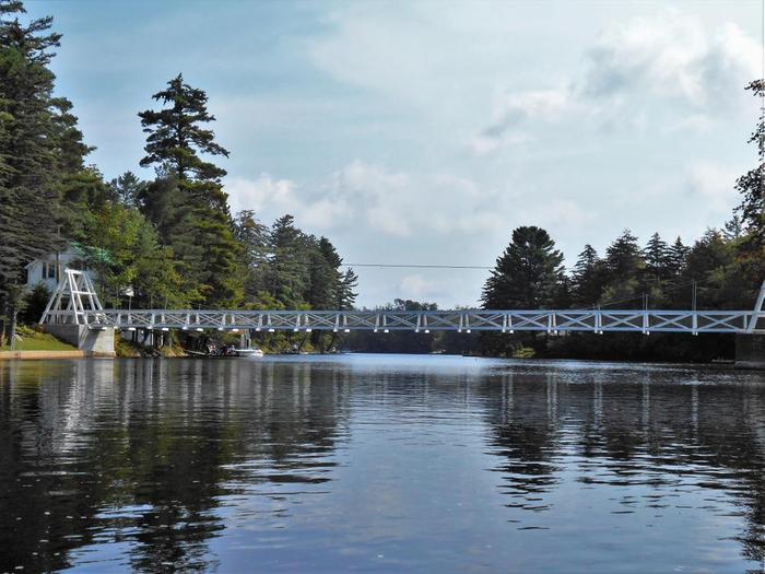 The Wanakena foot bridge over the Cranberry lake inlet, where the Oswegatchie river flows into the lake. (Credit: Wm Hill - Hiking the Trail to Yesterday)
