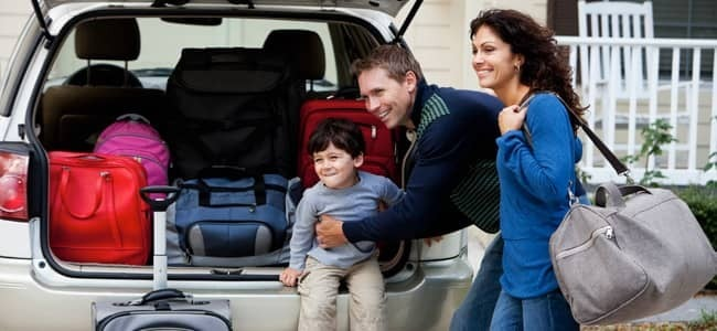 family packing car for trip