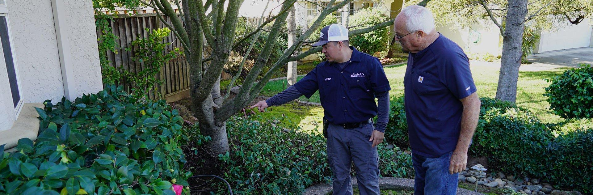 smith's pest management technician with client