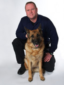 A trainer and his bed bug K9