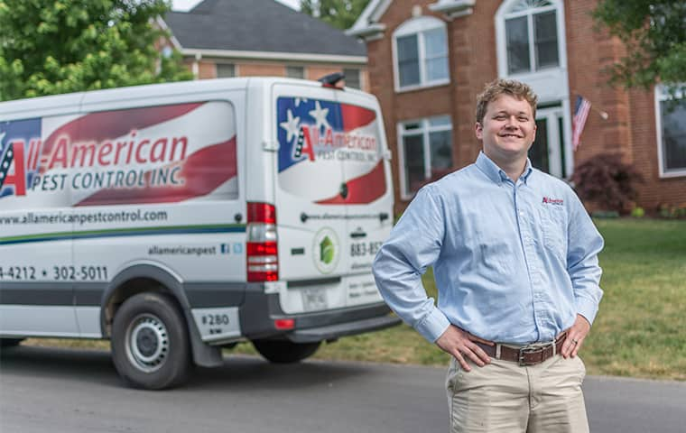 all american tech standing in front of service vehicle outside of clients home in old hickory tennessee