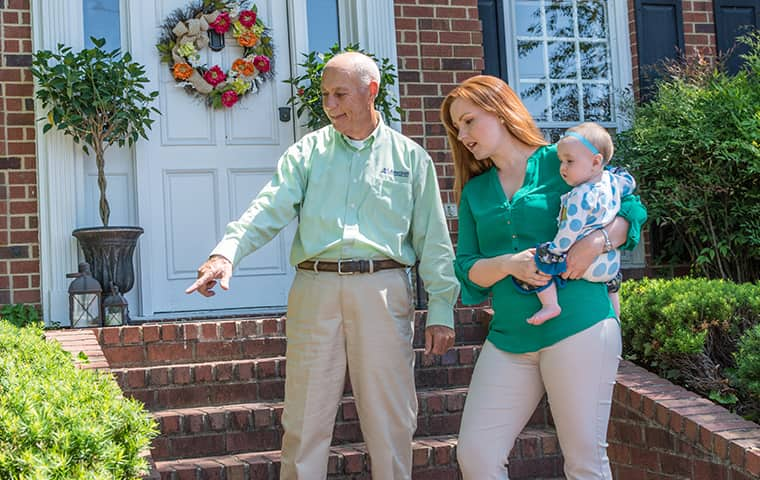 all american tech explaining services to client outside her smyrna tennessee home