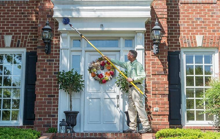 nashville tn pest control removing outdoor spider webs