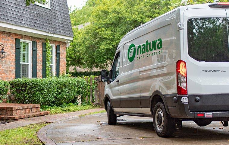 technician in company van outside home